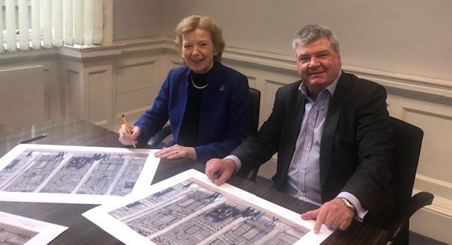 Mary Robinson, first woman President of Ireland, signs the limited edition prints of Entering the Four Courts with Paul Hanna