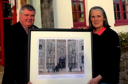 The Hon Mrs Justice Susan Denham, first woman Chief Justice of Ireland and Paul Hanna with the limited edition print of Entering the Four Courts
